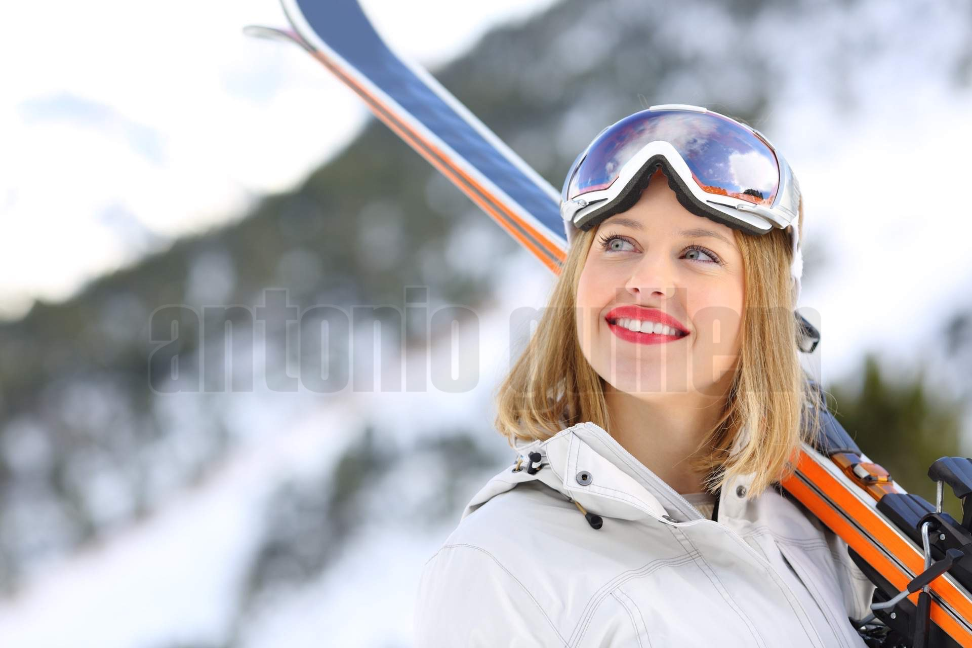 Happy skier looking above in the mountain