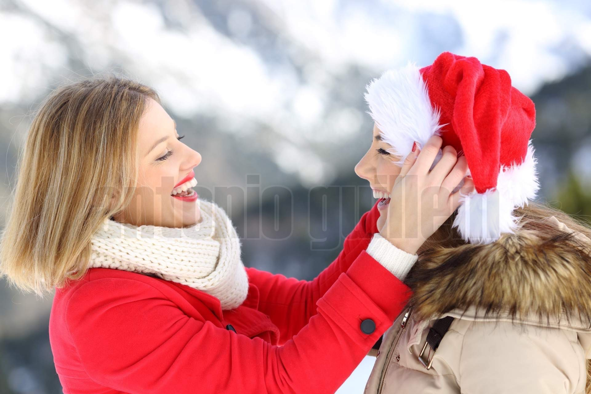 Two friends joking in christmas holidays
