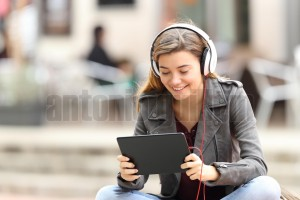 Girl learning on line with a tablet and headphones (3)
