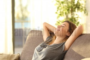Girl relaxing on a sofa at home (1)