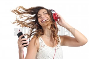 Happy girl dancing and listening to the music (1)