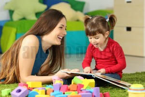 Mother and toddler playing with a book (3)