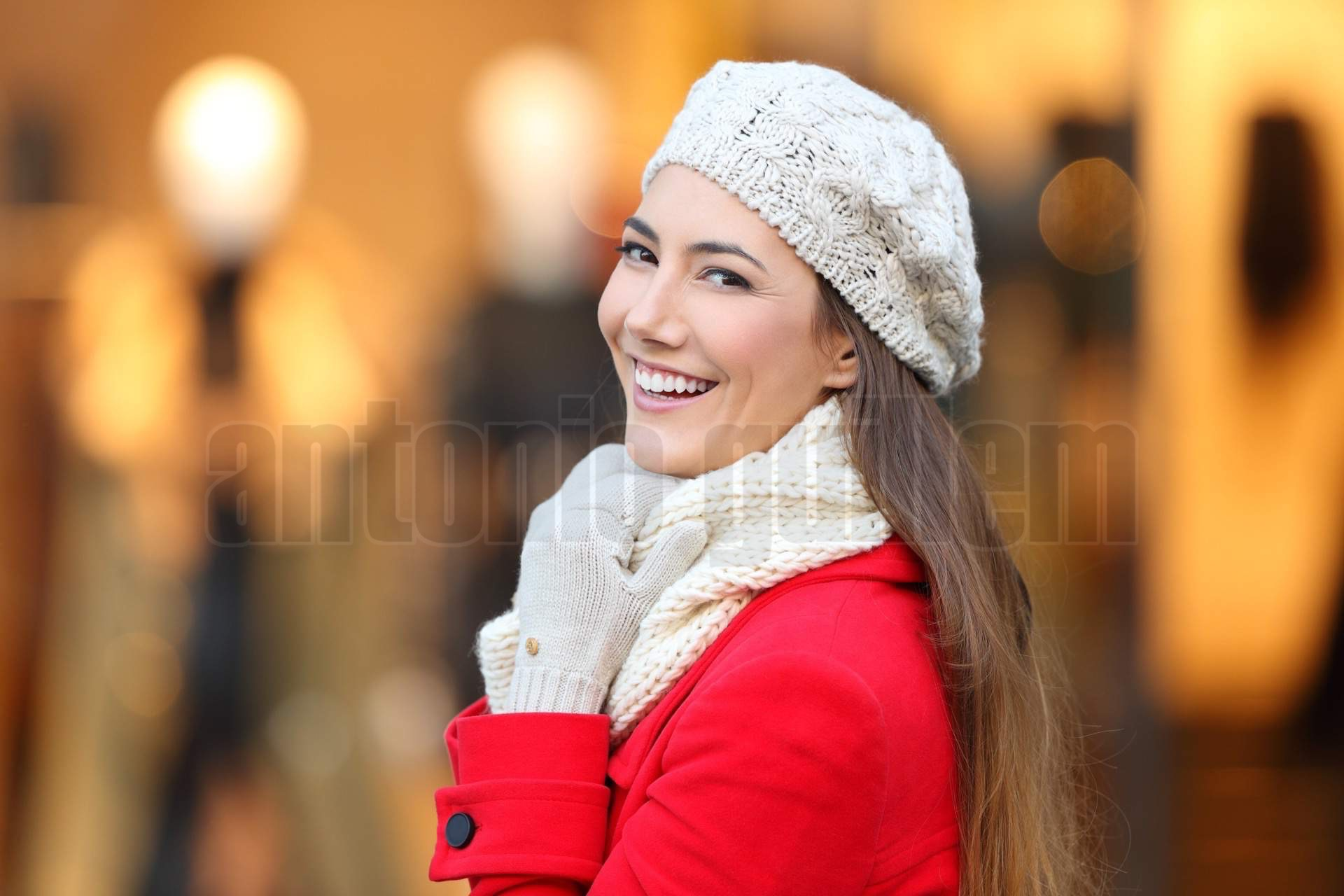 Woman smiling at camera in winter in a mall